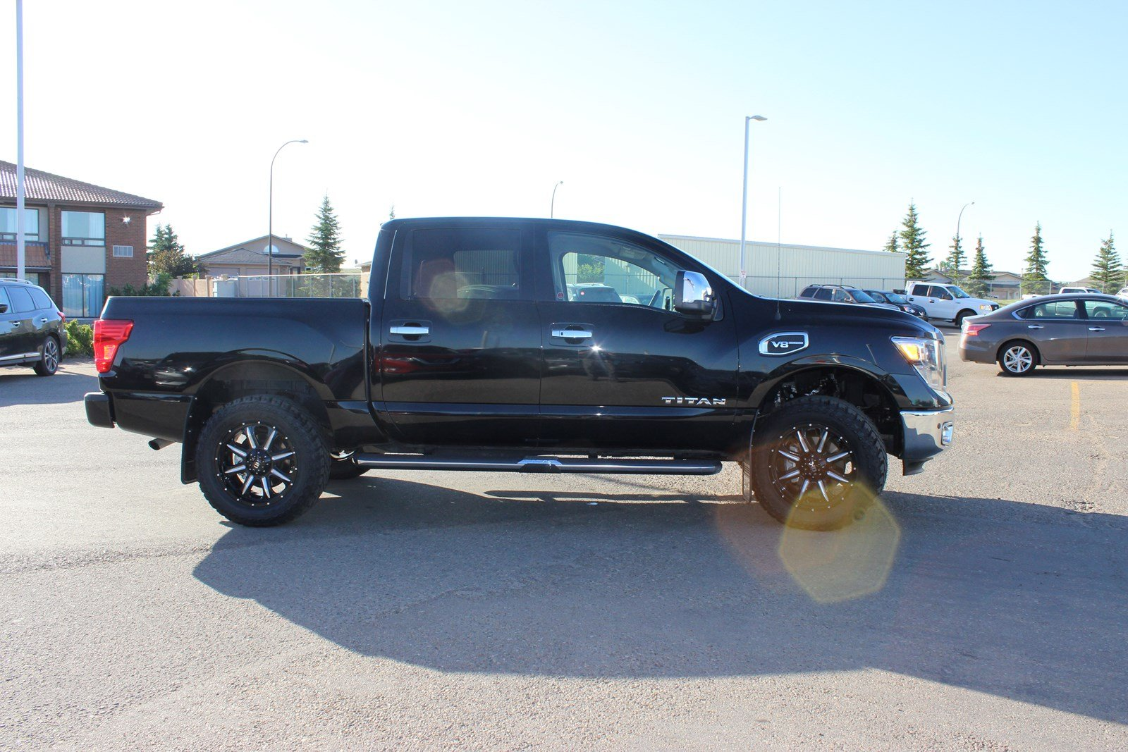 new 2017 nissan titan sl upgraded tires rims 2 inch level 25 off msrp crew cab pickup in. Black Bedroom Furniture Sets. Home Design Ideas